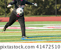 Soccer goalie kicking the ball 41472510