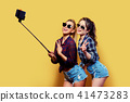 Fashion portrait of two friends posing. 41473283