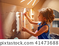 Charming girl playing in toy house 41473688