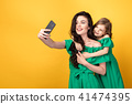 Awesome mother with daughter taking selfie 41474395