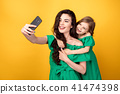 Awesome mother with daughter taking selfie 41474398