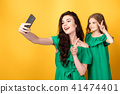 Awesome mother with daughter taking selfie 41474401
