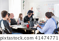 Relaxed informal IT business startup company team meeting. 41474771