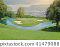 Golf course with gorgeous green and pond. 41479088