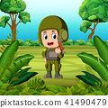 a soldier carrying a gun at the jungle 41490479