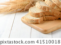 Sliced Whole wheat bread on wood block 41510018