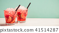 Red drink with ice 41514287