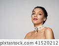 Beauty profile portrait of beautiful mixed race woman wearing chocker 41520212