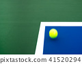 Tennis ball on the court in competition 41520294