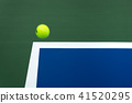 Tennis ball on the court in competition 41520295