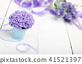 Violet flowers in blue metal bucket 41521397
