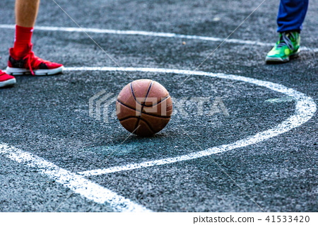 Basketball ball in the outdoors court lying on the ground 41533420