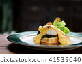 Breakfast food egg benedict , poached egg with yellow sauce with waffle and smoked salmon on wood background 41535040