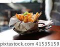 French fries in vintage style on wood background 41535159