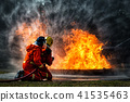 fireman using water fighting with fire flame 41535463