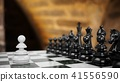3D Rendering pawn staying against set of chess 41556590