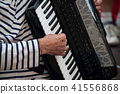 hands of man playing accordion in the street 41556868