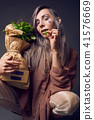 Stylish woman in biofuture pompadour style. 41576669