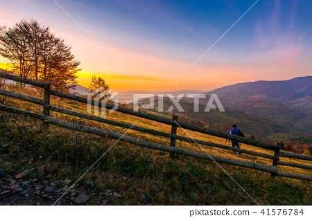 photographer on workshop at dawn in mountains 41576784