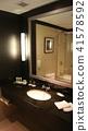 SINGAPORE - APR 2nd 2015: Modern dark bathroom interior design in a luxury hotel 41578592