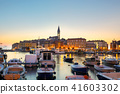 Colorful sunset of Rovinj town, Croatian fishing port on the west coast of the Istrian peninsula. 41603302
