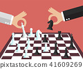 Two business people playing chess 41609269
