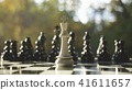 3D Rendering king staying against set of chess 41611657