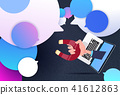 laptop hand hold magnet new idea chat support over bubbles background, pulling concept flat 41612863