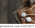Rock sugar and granulated sugar on wood spoon 41614072
