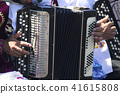 Hands of old man playing folk music on accordion 41615808