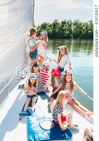 The children on board of sea yacht 41616617