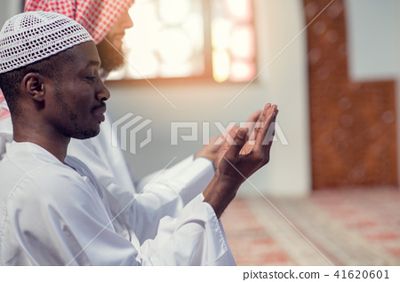 Two religious muslim man praying together inside the mosque 41620601