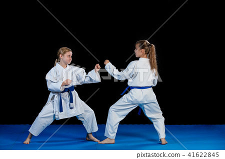 Karate martial Arts Two little girls demonstrate martial arts working together. 41622845
