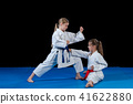 Karate martial Arts Two little girls demonstrate martial arts working together. 41622880