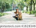 젊은여자, 개, 강아지, 애완동물, 골든 리트리버 41628346