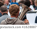 closeup of tuba player in the street 41628887