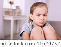Cheerless gloomy girl looking at you 41629752