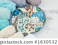Knitting threads and beads and seashells 41630532