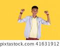 Joyful nice man celebrating his success 41631912