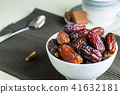 sweet dried dates fruit in small bowl 41632181
