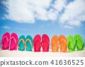 colorful flip flop on sandy beach 41636525