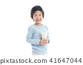 child drinking milk from a glass 41647044