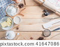 Ingredients and tools for homemade baking.  41647086