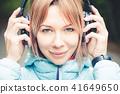 headphones, person, woman 41649650