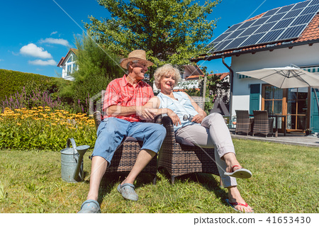 Happy senior couple in love relaxing together in the garden in summer 41653430