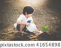 Cute Asian child watering young tree 41654898