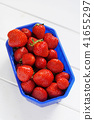 strawberries on white wooden table 41655297