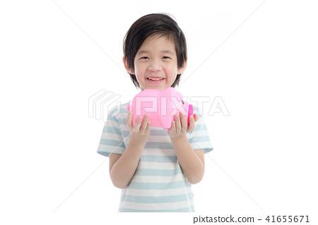 Asian child holding pink piggy bank  41655671