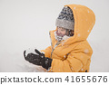 Happy Asian child playing in snow 41655676