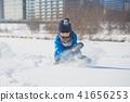 Asian child sliding on snow 41656253